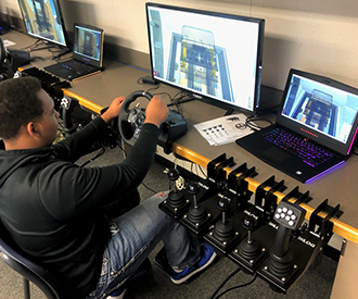 Citrus High School student using a construction simulator