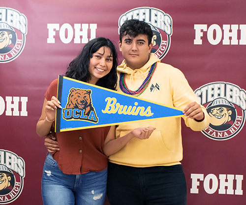 Fontana High School seniors take celebratory photos after submitting college applications during College Application Day on N