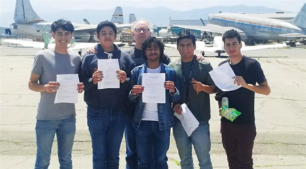 Photo ofEleven Henry J. Kaiser High School students received certification from the Federal Aviatio